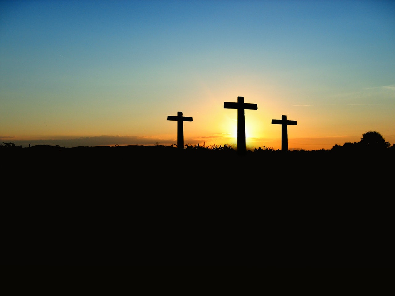 Christian cross at dawn